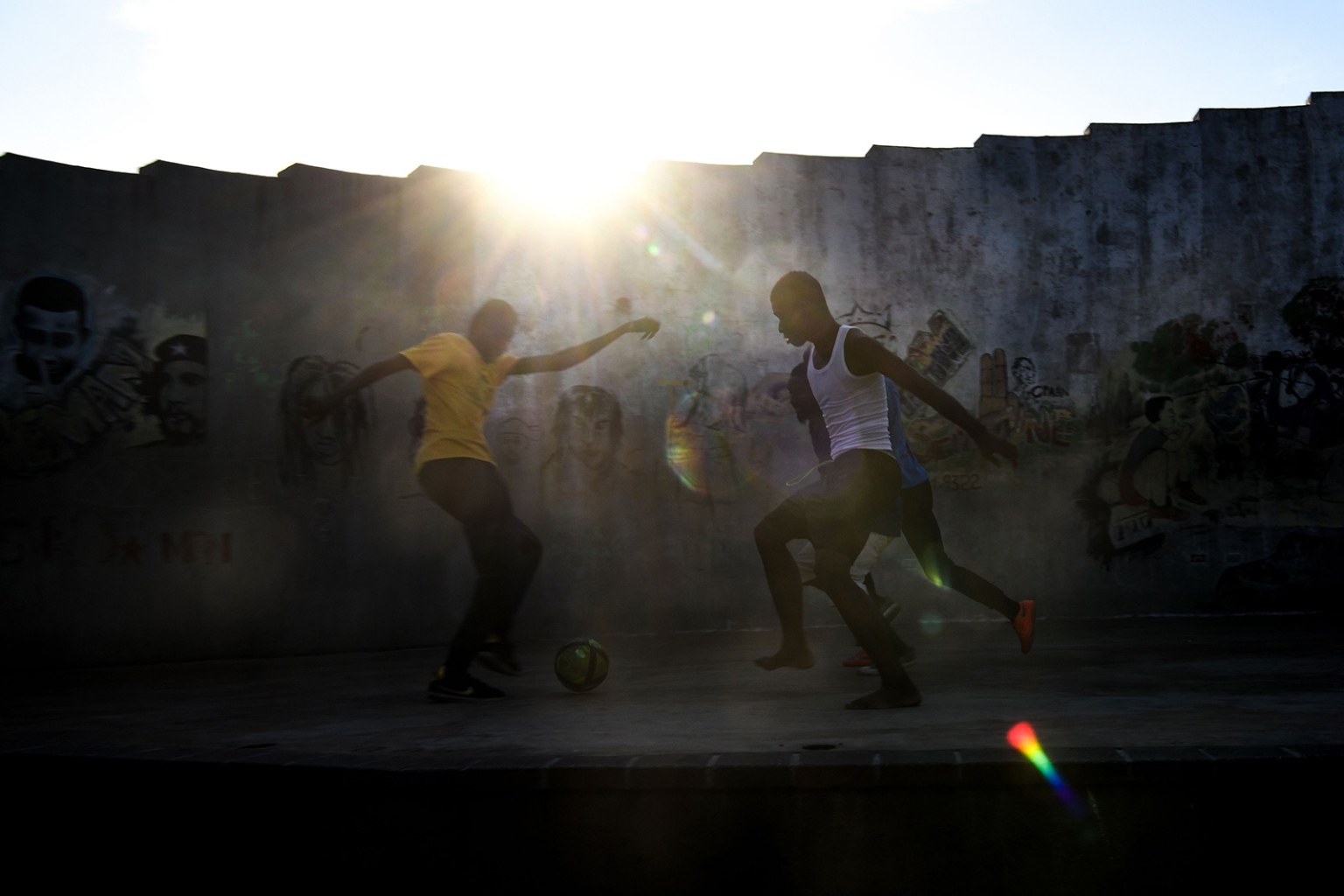 People play soccer in the Haitian capital Port-au-Prince on April 10. CHANDAN KHANNA/AFP/Getty Images