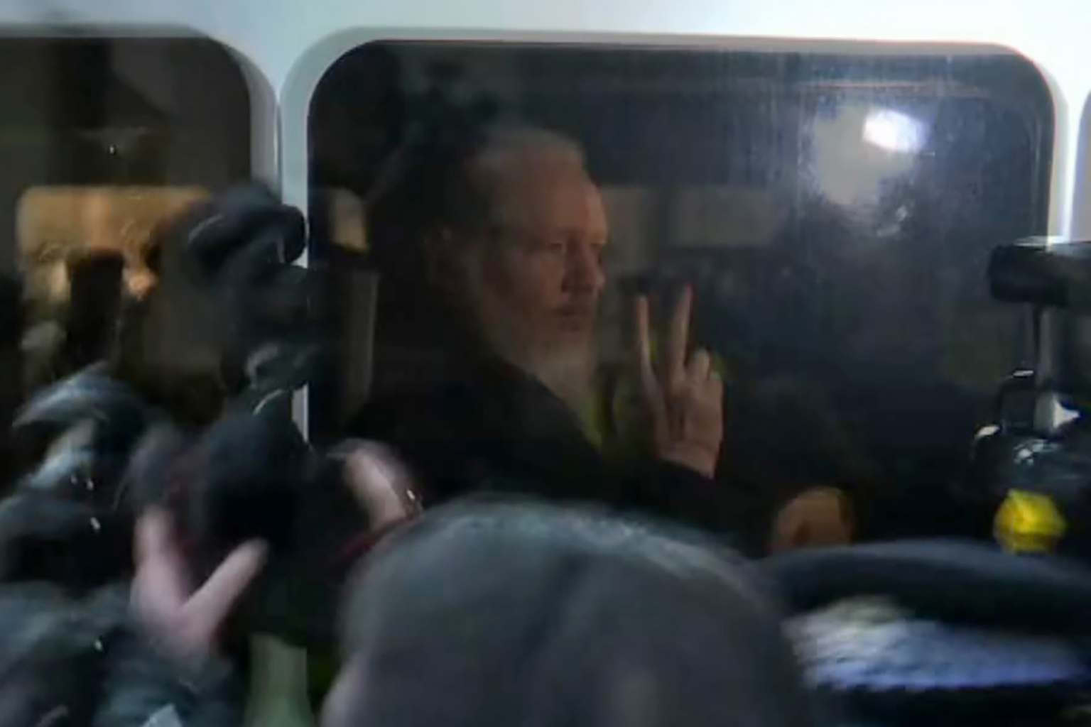 WikiLeaks founder Julian Assange is driven by British Police hours after being arrested in Ecuador's embassy on an extradition request from the United States on April 11. -/AFP/Getty Images