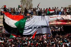 Sudanese demonstrators gather in central Khartoum after the toppling of President Omar al-Bashir on April 11. (Ashraf Shazly/AFP/Getty Images)
