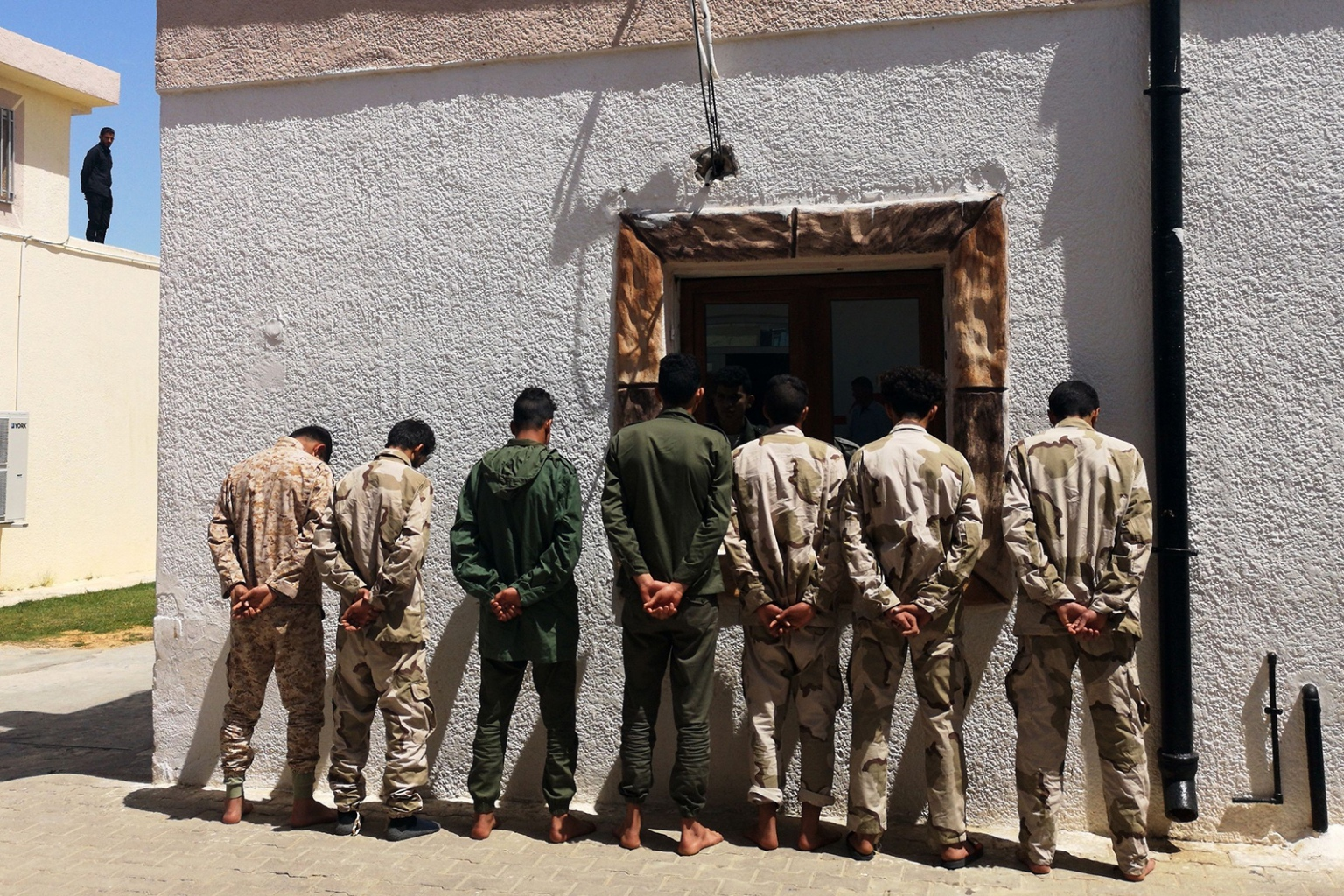Fighters loyal to military commander Khalifa Haftar, reportedly minors, are imprisoned by forces from the U.N.-backed Government of National Accord in Tripoli's suburb of Ain Zara on April 11. The area faced heavy clashes as Haftar's forces pressed an assault aimed at taking Libya's capital from the GNA. IMED LAMLOUM/AFP/Getty Images