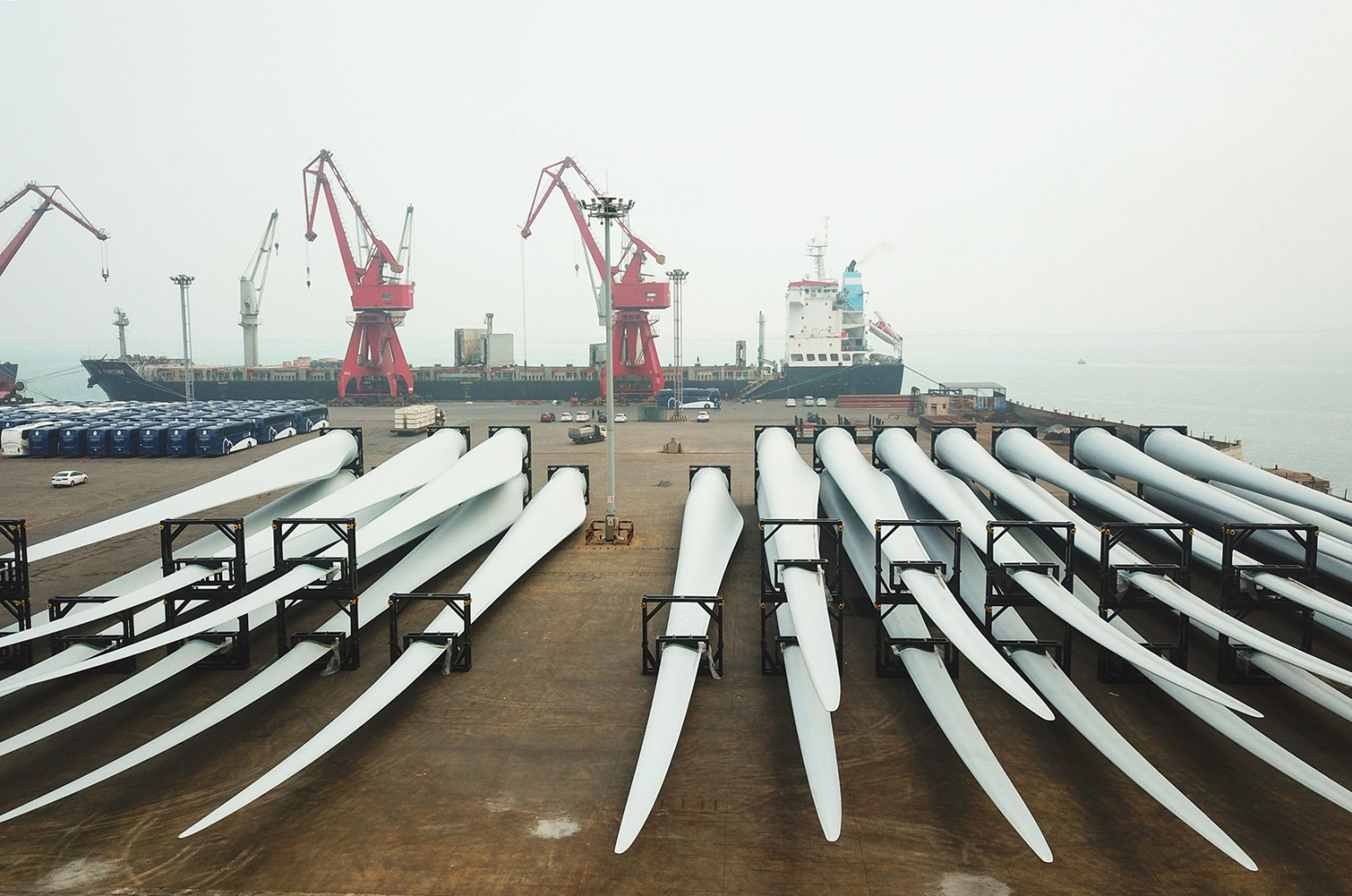 Wind turbine blades await export at a port in Lianyungang in China's eastern Jiangsu province on April 12. STR/AFP/Getty Images