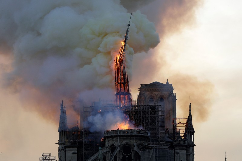 The spire of Notre Dame collapses as the cathedral is engulfed in flames in Paris on April 15. (Geoffroy Van Der Hasselt/AFP/Getty Images)