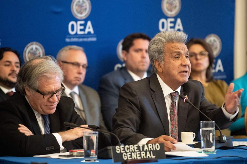 Organization of American States Secretary-General Luis Almagro (left) listens while Ecuadorian President Lenín Moreno speaks at the OAS in Washington on April 17. (Brendan Smialowski/AFP/Getty Images)