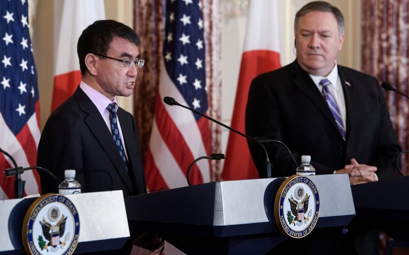US Secretary of State Mike Pompeo (R) listens while Japan's Foreign Minister Taro Kono speaks during a press conference after 2+2 meeting at the US Department of State April 19, 2019, in Washington, DC.