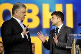 Incumbent Ukrainian President Petro Poroshenko, left, and his challenger for the presidency, Volodymyr Zelensky, debate at the Olimpiyskiy stadium in Kiev on April 19.