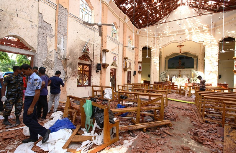 Sri Lankan officials inspect St. Sebastian's Church in Negombo, north of Colombo, after multiple explosions targeting churches and hotels on April 21.