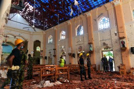 Security personnel inspect the interior of St. Sebastian's Church in Negombo on April 22, 2019, a day after the church was hit in series of bomb blasts targeting churches and luxury hotels in Sri Lanka. (ISHARA S. KODIKARA / AFP)
