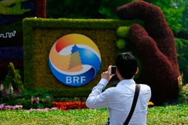 A man takes photo of a sign promoting the Belt and Road Forum in Beijing on April 22.