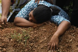 A Sri Lankan woman cries during a burial service for a bomb blast victim in a cemetery in Colombo on April 23, two days after a series of bomb attacks targeting churches and luxury hotels in Sri Lanka.