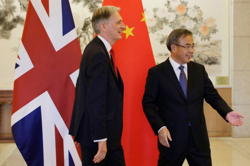 Britain's Chancellor of the Exchequer Philip Hammond meets with China's Vice Premier Hu Chunhua ahead of the big Belt and Road summit in Beijing on Apr. 25.