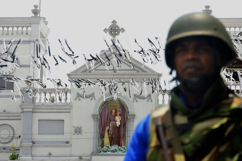 Sri Lankan security forces secure the area around St. Anthony's Shrine in Colombo on April 21.