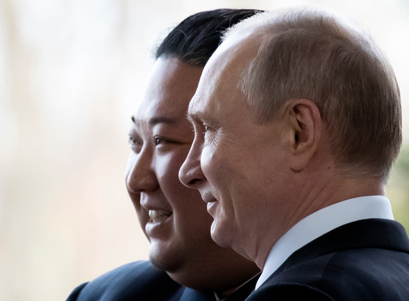 Russian President Vladimir Putin welcomes North Korean leader Kim Jong Un prior to their talks at the Far Eastern Federal University campus on Russky Island in Vladivostok, Russia, on April 25.