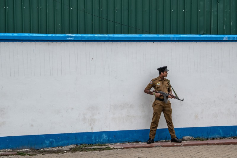 A police officer guards the area near Dawatagaha Jumma Masjid ahead of Friday prayers in Colombo, Sri Lanka, on April 26.
