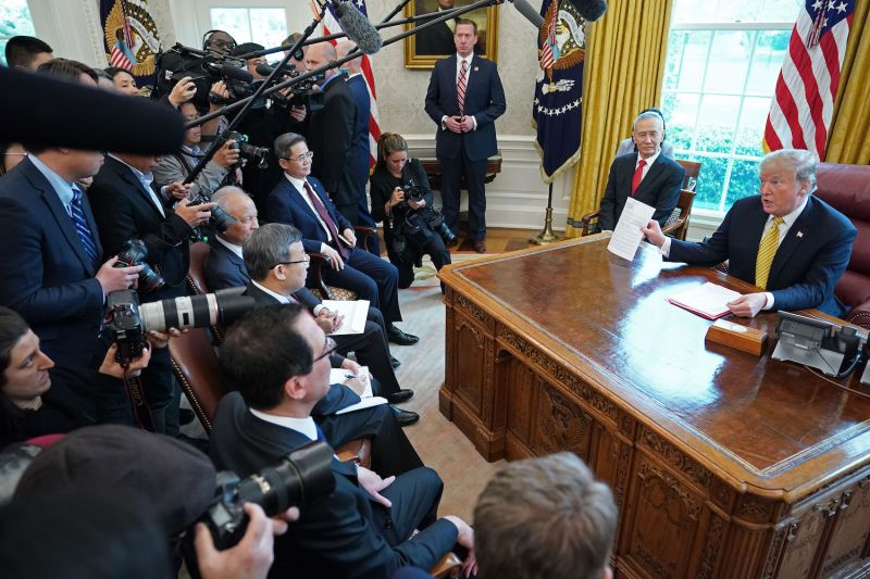 U.S. President Donald Trump, right, and Chinese Vice Premier Liu He talk to reporters at the White House on April 4. (Chip Somodevilla/Getty Images)