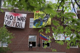 A protester sits on a window of the Venezuelan Embassy in Washington on April 25.
