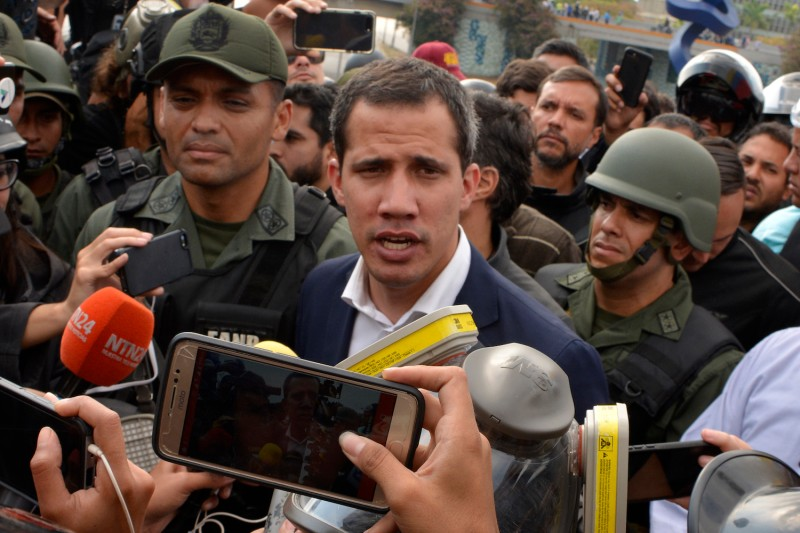 Juan Guaidó talks to media outside La Carlota Air Base in Caracas on April 30.