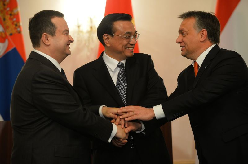 Serbian Prime Minister Ivica Dacic, Chinese Prime Minister Li Keqiang, and Hungarian Prime Minister Viktor Orban shake hands at a summit of 16 Central and Eastern European leaders looking to woo Chinese investment in Bucharest on Nov. 25, 2013. (Daniel Mihailescu/AFP/Getty Images)