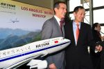 Los Angeles Mayor Eric Garcetti, left, and Zhihang Chi, Air China's vice president for North America, at Los Angeles International Airport on Feb. 19, 2015. (Mark Ralston/AFP/Getty Images)