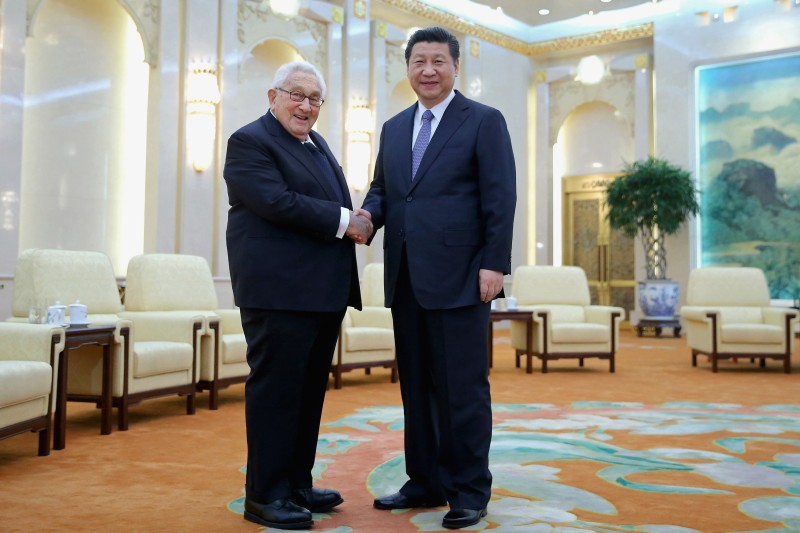 Chinese President Xi Jinping shakes hands with former United States Secretary of State Henry Kissinger at the Great Hall of the People on March 17, 2015 in Beijing, China. (Feng Li/Getty Images)