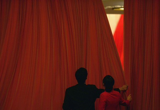 Chinese attendants close the curtains at the end of the National People's Congress in Beijing on March 14,  2005.  (Cancan Chu/Getty Images)