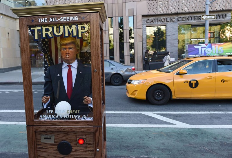 A fortune-telling fairground attraction bearing the likeness of Donald Trump stands at Washington Square Park in New York on Oct. 14, 2016. (Timothy A. Clary/AFP/Getty Images)