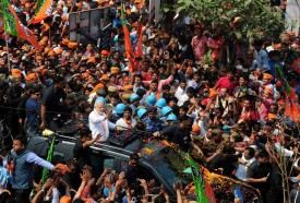 Indian Prime Minister Narendra Modi and leader of the Bharatiya Janata Party gestures during a roadshow in support of the party's state assembly election party candidates in Varanasi on March 4. (Sanjay Kanojia/AFP/Getty Images)