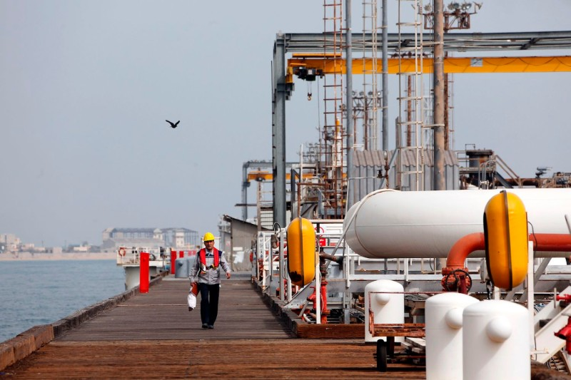 An Iranian laborer walks on the platform of the oil facility on Kharg Island off the coast of Iran.