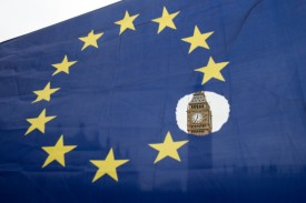 An EU flag with one of the stars symbolically cut out in front of the Houses of Parliament shortly after British Prime Minister Theresa May announced to the House of Commons that Article 50 had been triggered in London on March 29, 2017. (Oli Scharff/AFP/Getty Images)