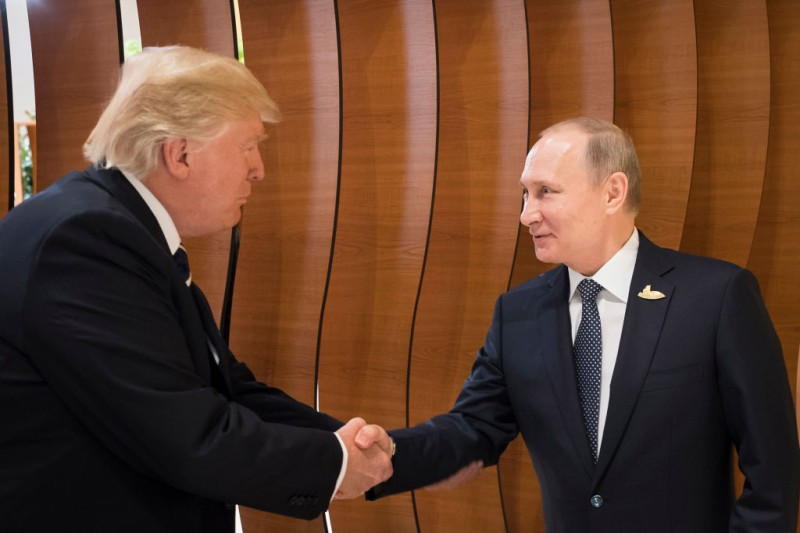 Donald Trump meets Vladimir Putin at the opening of the G20 summit on July 7, 2017 in Hamburg, Germany. (Steffen Kugler/BPA via Getty Images)
