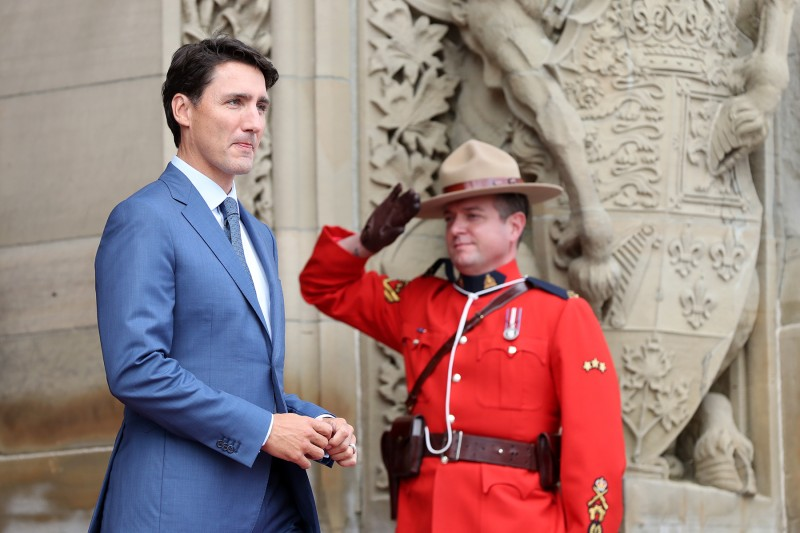 A mountie salutes Canadian Prime Minister Justin Trudeau outside Parliament in Ottawa, Ontario, on Aug. 29, 2017.  (Lars Hagberg/AFP/Getty Images)