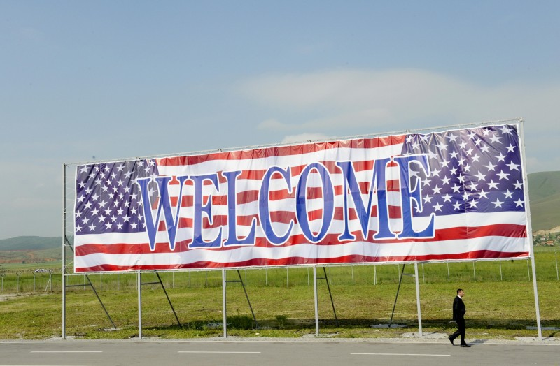 A security guard walks past a welcoming banner at Pristina International Airport prior to the arrival of the U.S. Vice President Joe Biden in Kosovo on May 21, 2009. (Armend Nimani/AFP/Getty Images)