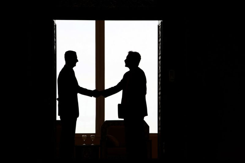 Syrian President Bashar al-Assad  shakes hands with U.S. under secretary for political affairs William Burns ahead of their meeting in Damascus on Feb 17, 2010. (Louai Beshara/AFP/Getty Images)