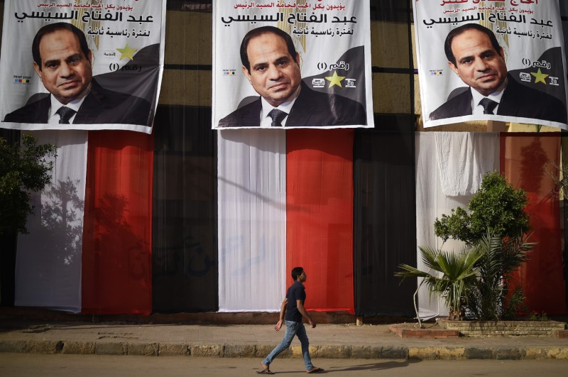 A polling station in Cairo's western Giza district on March 25, 2018, ahead of the vote scheduled to begin the following day, decorated with electoral posters depicting President Abdel Fattah al-Sisi. (Mohamed El-Shahed/AFP/Getty Images)
