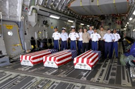 US soldiers stand next to coffins bearing the remains of missing soldiers from the Vietnam War on a military transport plane during a repatriation ceremony at Danang airport on April 15, 2018. (Linh Pham/AFP/Getty Images)