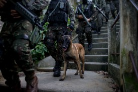 Members of Brazil's armed forces patrol the favelas of Chapéu Mangueira and Babilônia in Rio de Janeiro on June 21, 2018.