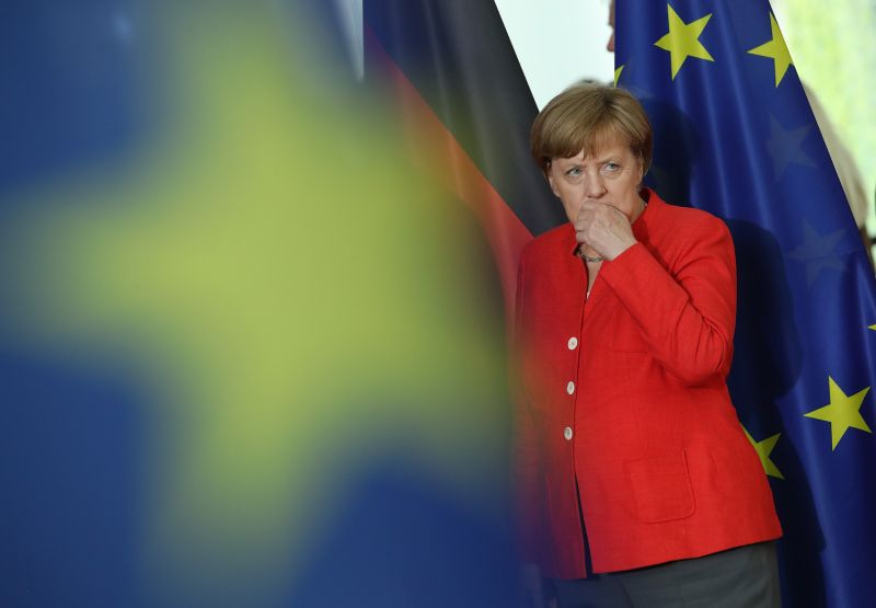 German Chancellor Angela Merkel stands among flags as she attends a signing ceremony after consultations between China and Germany in Berlin on July 9, 2018. (Sean Gallup/Getty Images)