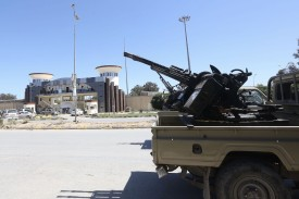 Gun-mounted vehicles belonging to fighters loyal to the Libyan Government of National Accord (GNA) near a military compound in a suburb of Tripoli on April 9.