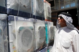 A customer looks at an Iranian-made washing machine at a store in the Iraqi capital, Baghdad, on Aug. 8, 2018.