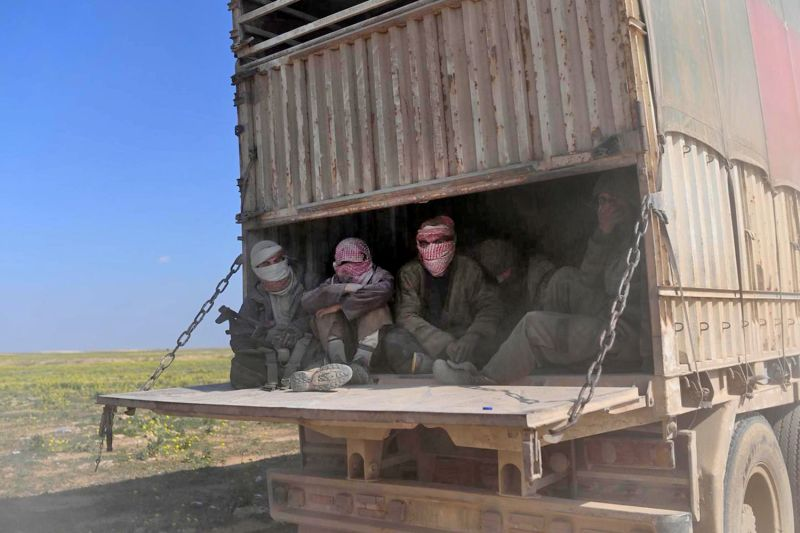A truck carrying Islamic State fighters who surrendered to Kurdish-led Syrian Democratic Forces (SDF), as they are transported out of  Baghouz in Syria's northern Deir Ezzor province on Feb. 20, 2019.
