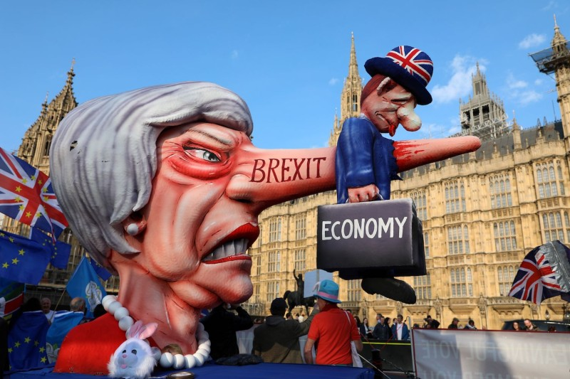 Anti-Brexit activists demonstrate with a model of Theresa May outside the Houses of Parliament in London on April 1, 2019, as MPs debate alternative alternative options for Brexit
