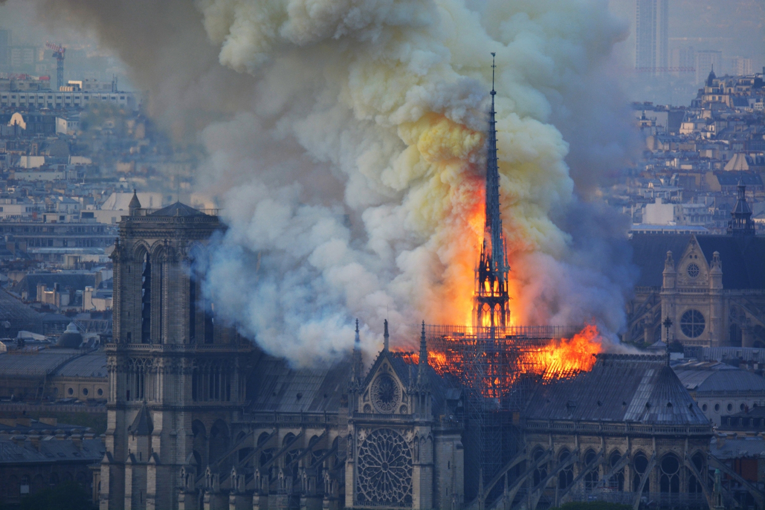 Smoke and flames engulf the spire and roof of the the Notre Dame Cathedral in Paris on April 15. The church was constructed betwen 1163 and 1345. (Hubert Hitier/AFP/Getty Images)