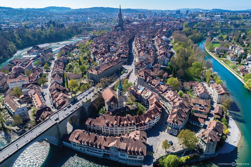 Bern old quarter with the Aare river flowing around the capital city