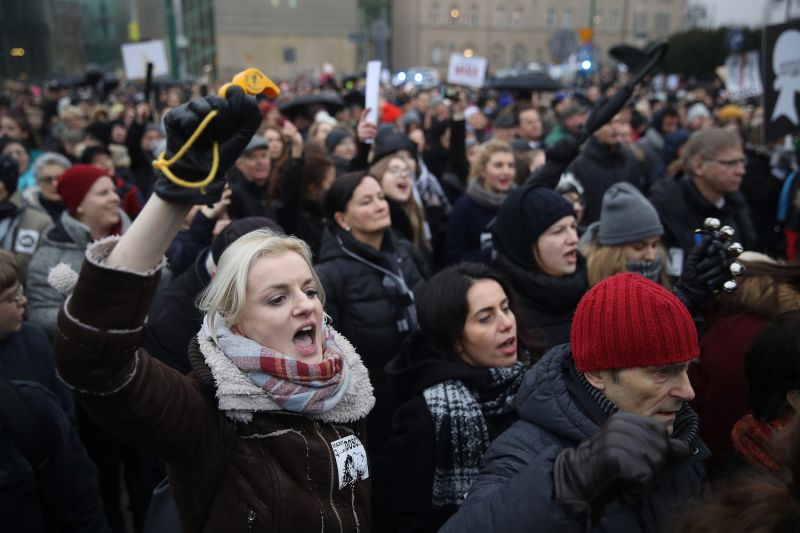 "People protesting against a new government measure to further restrict abortions in Poland gather as part of ""Black Friday"" demonstrations nationwide on March 23, 2018 in Poznan, Poland. The women's rights group Dziewuchy Dziewuchom, called on women across Poland to gather for protests in cities nationwide."