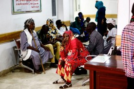 A picture taken on July 25, 2017 shows Sudanese patients waiting in a hallway at the Radiation and Isotopes Centre in  Khartoum. In Sudan access to drugs and treatment was impaired by U.S. sanctions.