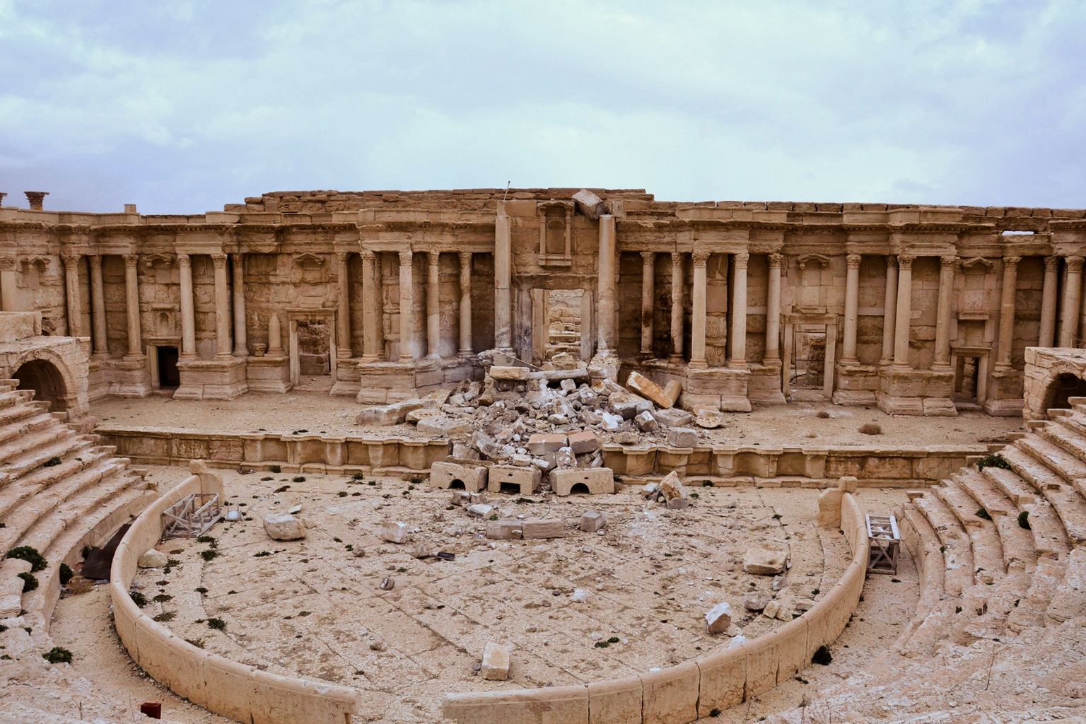 Damage in Palmyra after Syrian troops recaptured the ancient city from the Islamic State group on March 2, 2017. Miliants destroyed the facade of the Roman amphitheater, a 2nd-century Unesco World Heritage site. (Stringer/AFP/Getty Images)