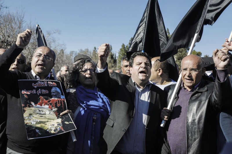Ayman Odeh (C), and  Ahmad Tibi (L), lead a demonstration by Arab Israelis against house demolitions carried out by Israeli authorities in Arab neighborhoods, in front of the Knesset  in Jerusalem on January 23, 2017.