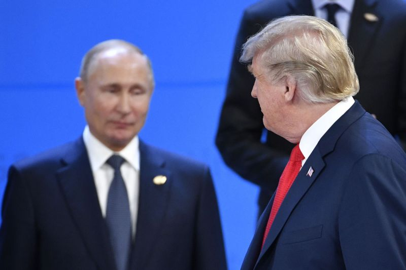 U.S. President Donald Trump looks at Russia's President Vladimir Putin as they take their places for a group photo during the G-20 Leaders' Summit in Buenos Aires on Nov. 30, 2018.
