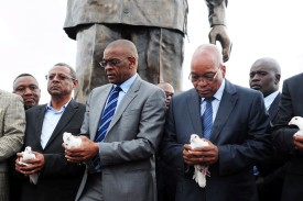 Jacob Zuma (right), the then-president of South Africa, and Ace Magashule, the then-premier of the Free State, ready to release white doves during the unveiling of the Nelson Mandela statue in Bloemfontein, South Africa, on Dec. 13, 2012.