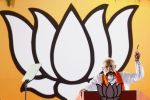 Indian Prime Minister Narendra Modi delivers a speech at an election rally ahead of Phase VI of India's general election in Allahabad on May 9.
