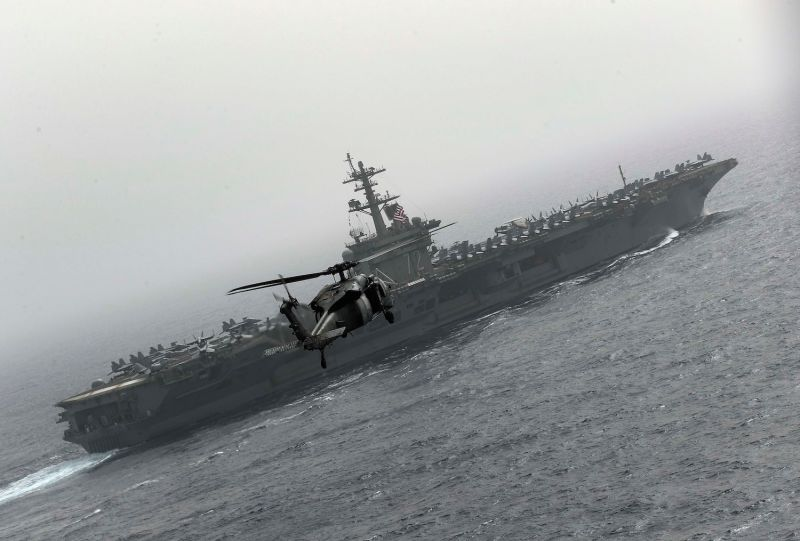 The Nimitz-class aircraft carrier USS Abraham Lincoln sails with the Abraham Lincoln and John C. Stennis carrier strike groups as they conduct carrier strike force operations in the U.S. 6th fleet.